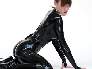 Actress in latex catsuit and ballet boots.
