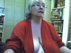 Heavy saggy granny strips and masturbates on webcam