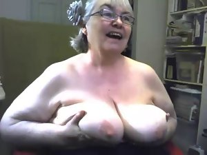 The fatty and saggy gran is singing and showing knockers