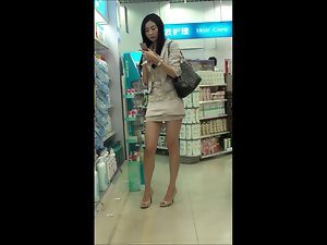 Comely chinese lassie in public