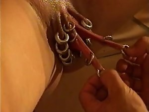 heavily pierced experienced snatch gets fist screwed