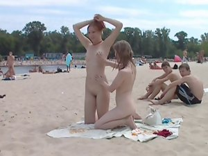 Raunchy 18 years old nudists play with each other in sand