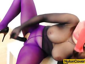 Huge titties bombshell in nylon mask and full body nylon suit