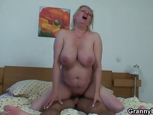 Moaning granny rides his 19yo rod