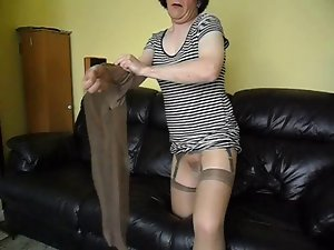 Glossy pantyhose,nylons and fake penis