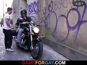 Lewd looking biker is seduced by a gay