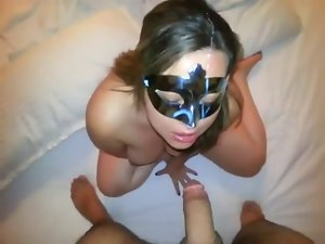 Stroking masked receives sperm on her mask tart