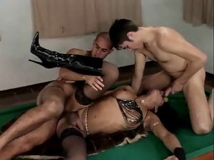 TS in knee boots gets fucked by 2 fellows
