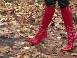 attractive lassie walking in leatherfetish panty, corset & red boots