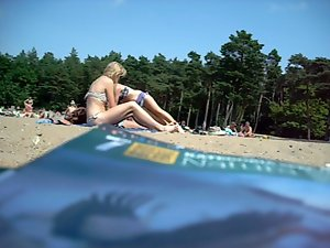 19yo tempting blonde lady sunbathing in public beach in Poland
