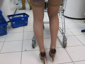 Lady in blue dress and tan stockings in supermarket 2