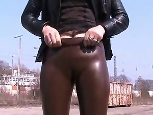 showing us her latex bum & cameltoe