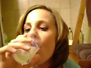 Amateur Nympho Drinking a Glass of Cum