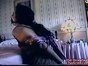 Dark haired Bound in her bedroom