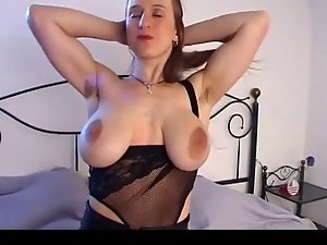 Buxom chick with big saggy knockers & shaggy vagina masturbates