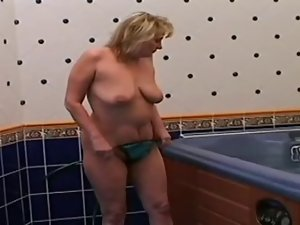 obese aged is stroking and banging in the Jacuzzi