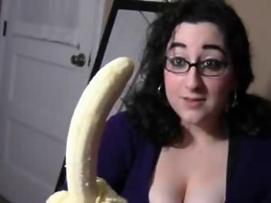 Big boob dark haired licking banana