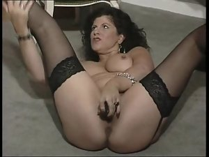 English vixen Gilly plays with herself in various episodes