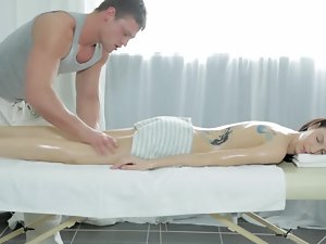 A tense body is getting taken care off on the massage table