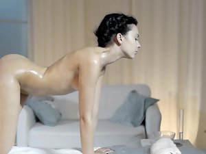 An oiled up princess is getting a blow job done to her masseur