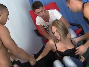 Three 18 years old gentlemen are ready to fuck this light-haired vixen in fishnets