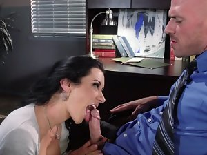 A luscious secretary is in the office, licking a large shaft