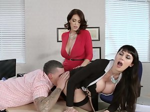 Two females are getting banged in the office by a alluring 19 years old dude