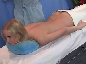 Check out how a blonds butt gets massaged on the massage table