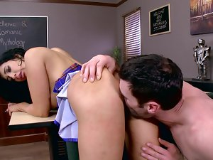 A raven haired cutie is getting screwed in an empty office room