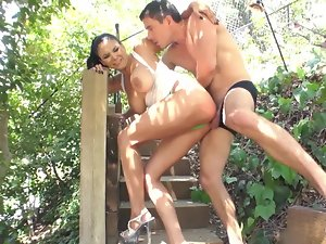 A dark haired that find enjoyment in stroking pecker is seen nude in the yard