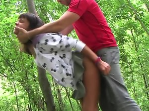Raven haired seductive teen fuck partner gets thumped in the forest by two dudes