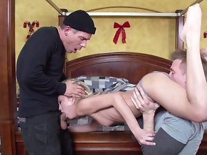 Lewd blondie wench is getting banged by two men in the bedroom