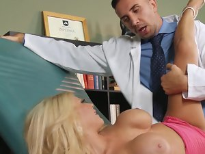 A light-haired with large knockers is getting shagged rough by her doctor