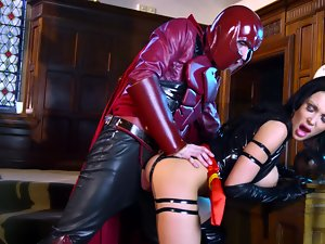 A raven haired lady in latex is getting a shaft inside her fleshy pussy