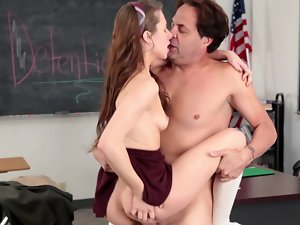 A sensual redhead is jumping on her luscious and sensual teacher in the class
