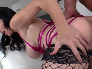 Glamorous slutty girl in fishnet stockings strapon bangs his dirty ass