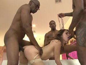A diminutive thing is banged by several black men in a gangbang
