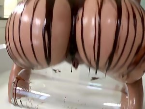 Blond covers herself and her man in chocolate. She eats cum as well