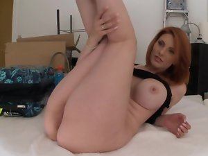 Redhead with a large butt and firm large knockers has fun with a man