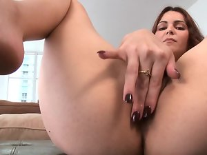 After she plays with her pussy, the dark haired gives a blow job