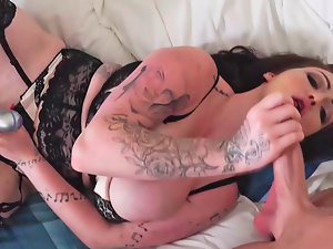 Buxom female in stockings is massaging her vagina with a toy