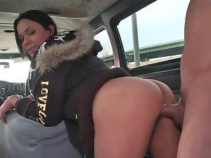 Top heavy dark haired Fernanda rides a penis in a car like a hussy