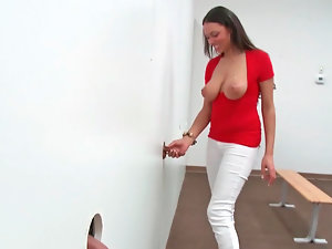 Bethany Benz performing unbelievable blowjob through some glory hole