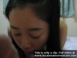 attractive asian girl gives a cock sucking