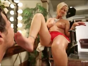 Mommy gets a foot cumshot
