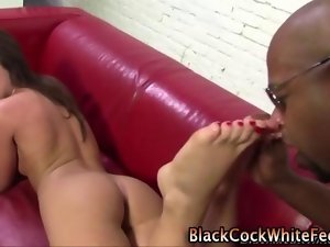 Luscious fetish interracial hussy giving a tempting footjob