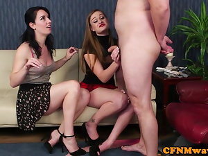Female domination duo taunting nude sub on their knees